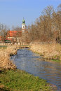 Village church and little brook german landscape Royalty Free Stock Photos