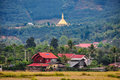 Village and golden stupa in Luang Nam Tha, Laos Royalty Free Stock Photo