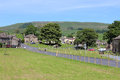Village green and main road bainbridge yorkshire view across the from hawes down wesleydale with the rose crown pub in the Royalty Free Stock Photography