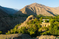 Village in high mountains small on precipitous bank of mountain river highland valley tajikistan summer morning view Stock Photography