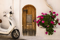 Village house in crete greece exterior of a small with colourful flowers and a scooter parked outside kritsa Royalty Free Stock Images