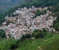 Village over terraced rice fields in Yuanyang, Yunnan Province, Royalty Free Stock Photo