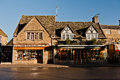 Village scene bourton on the water uk cotswolds gloucestershire england Royalty Free Stock Photo