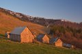 Village of shepherds in the mountains spring landscape with wooden light setting sun carpathian ukraine europe Royalty Free Stock Images