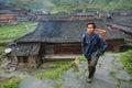 Villager asian man peasant farmer with a wicker basket on his ba yao village dazhai longsheng guangxi province china april one Stock Image