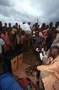 Villagers listening to pedal-powered radio, Uganda Royalty Free Stock Photography