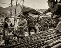 Villagers negotiate price at central open market at sapa vietnam vintage feel in black and white of minority tribes doing business Royalty Free Stock Photography