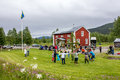 Villigars dancing around the pole locals are celebrating midsummer in a small village on its community centre lawn lappland Royalty Free Stock Photography