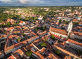 Vilnius Old Town with St. Anne Church and St. Johns Church Bell Tower with  Uzupis Republic in Background. Royalty Free Stock Photo