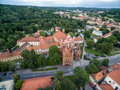 Vilnius Old Town and St. Anne Church with Uzupis district and Republic in Background. Lithuania. Royalty Free Stock Photo
