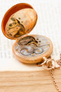 Vinatge pocket watch vintage gold lying on a book Royalty Free Stock Photography