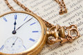 Vinatge pocket watch vintage gold lying on a book Royalty Free Stock Photo