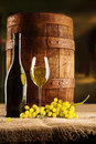 Vine composition old barrel with wineglass bottle and winegrape on table Stock Images
