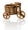 Vinewoven souvenir tricycle with basket homemade in potpourri style a that can be used as a stand for flowers for bottles Stock Photos