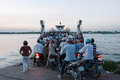 Vinh long vietnam march crowd bikers trying to access evening ferry across mekong river vinh long to ben tre Royalty Free Stock Image