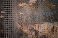 The vintag rusty grunge steel decorated by drilling a wall textured background. Royalty Free Stock Photo