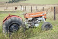 Vintage Abandoned Red Massey Ferguson 135 Tractor and Horses Royalty Free Stock Photo