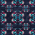 Vintage abstract colored flowers on a blue background seamless pattern grunge texture Royalty Free Stock Photo
