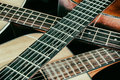 Vintage acoustic guitar necks crossed three guitars with their Royalty Free Stock Images