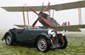 Vintage aeroplane and motorcar bicester uk january a morgan sportscar ww be e biplane are displayed at the bicester heritage site Royalty Free Stock Image