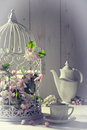 Vintage afternoon tea with birdcage filled with spring blossom Royalty Free Stock Photos