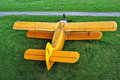 Vintage airplane yellow biplane on the ground Stock Images