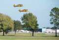 Vintage airplanes taking off from airport Stock Image