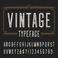 Vintage alphabet vector font with distressed overlay texture typeface scratched type letters numbers and symbols on a dark Stock Photo