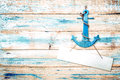 Vintage anchor on old wooden background with blue paint Royalty Free Stock Photo