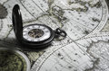 Vintage antique pocket watch on old map background Royalty Free Stock Photo