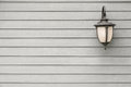 Vintage Antique wall lamp on grey wood wall, for background with Royalty Free Stock Photo