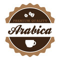 Vintage arabica coffee label round with cup and beans silhouette Royalty Free Stock Photography