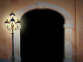 Vintage arched doorway with glooming lantern on black background Stock Photography