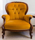 Vintage armchair antique orange isolated on white background Royalty Free Stock Photo