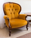 Vintage armchair antique orange isolated on white background Royalty Free Stock Image