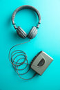 The vintage audio player and headphones. Royalty Free Stock Photo