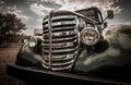 Vintage auto front grill and headlights of automobile with filter applied Stock Photo