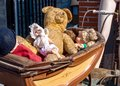 Vintage baby car with teddy bear and dolls