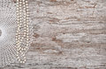 Vintage background with bead necklace and lace on the old wood Royalty Free Stock Photo