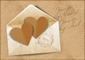 Vintage background with envelope and hearts Stock Photo