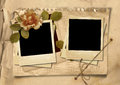 Vintage background with old polaroid frames and rose shabby photo album frame the space for text or photo Royalty Free Stock Photography