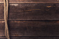 Vintage background with old rope on wood planks Royalty Free Stock Photo