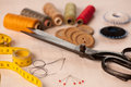 Vintage background with sewing sewing kit scissors bobbins wit thread and needles Stock Photography
