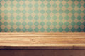 Vintage background with wooden deck table over retro wallpaper Royalty Free Stock Photo