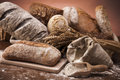Vintage bakery traditional set of bread loaves and other ingredients Stock Images