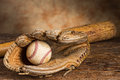 Vintage baseball memories old bat with ball and weathered glove Stock Image