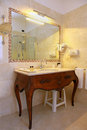 Vintage bathroom batroom interior with antique wooden basin Stock Photos