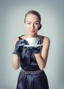 Vintage beautiful fashion girl with coffee cup portrait of young a in classic style Stock Image