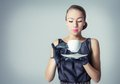 Vintage beautiful fashion girl with coffee cup portrait of young a in classic style Royalty Free Stock Photography