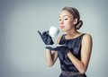 Vintage beautiful fashion girl with coffee cup portrait of young a in classic style Royalty Free Stock Photos